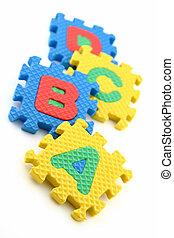 Puzzle pieces of alphabets