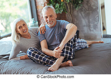 Positive lovign aged couple lying on the bed - Nice morning....