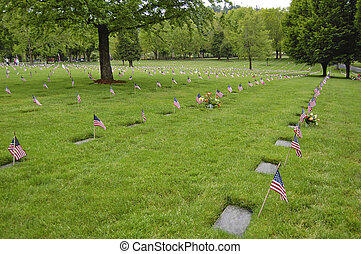Flags decorate veterans graves at Willamette National...