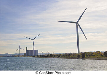 Wind turbines generate electricity along the Rhone river in France