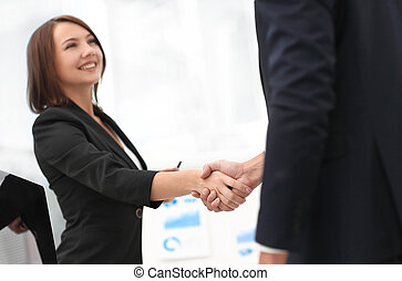 business colleagues shaking hands after a successful...