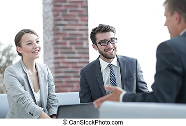 members of the business team talking to a client - members...