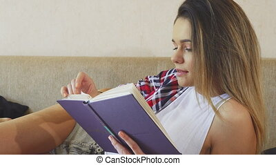 The young girl is reading a book
