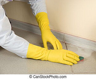 washing - Hands in yellow gloves with sponge, washing floor...