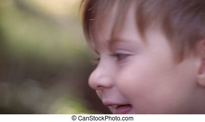 Close up of a happy smiling young child being pick up by father