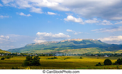 Village in the background of the rocky mountains