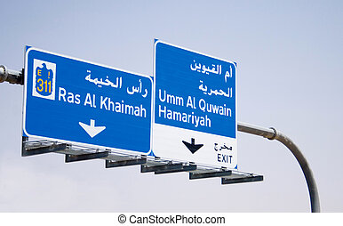 Traffic Sign Board on Emirates Road - English and Arabic...
