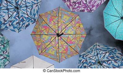 Colorful umbrellas against sky
