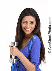 Health cautious woman with dumbbell