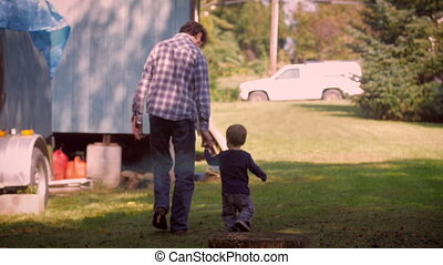 Man and child holding hands and walking away together - Slow...