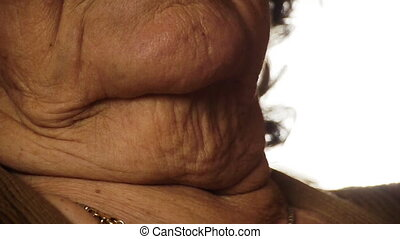 Senior old woman throat neck wrinkle skin close up 2