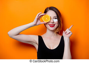 Woman using eye patch for her eyes and holding fruit on...