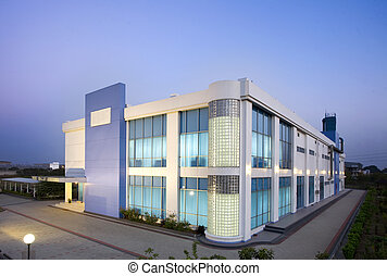 Modern office center - modern office building exterior in a...