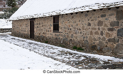Churchyard of an Orthodox small chapel in winter -...