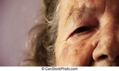 Senior old woman face eye wrinkle skin close up