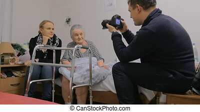 Visiting elderly grandma and making photos with her - Man...