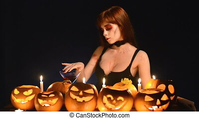 Woman with Halloween pumpkins - Sexy woman in Halloween...