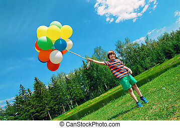 happy childhood concept - Happy boy enjoys with a sunny...