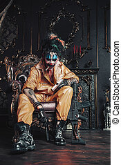 dangerous clown with guns - Evil clown man stained in blood...