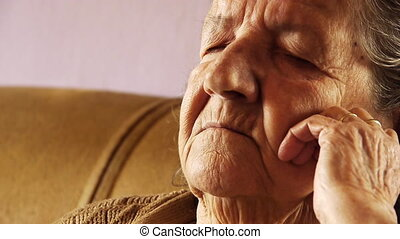 Senior old woman take nap sleep wrinkle skin