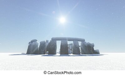 Stonehenge in winter - Stonehenge covered with snow falling...