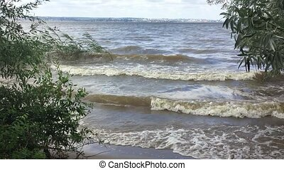 wave storm slow motion video on the river. big waves on the...