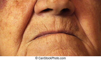 Senior old woman mouth wrinkle skin close up