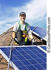 Solar panel installation - Man installing alternative energy...
