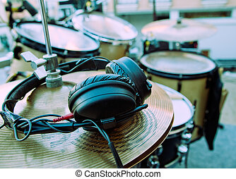 drum and headphones - Close-up image of drum and headphones