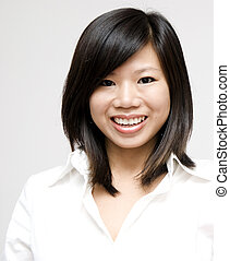 Young Asian woman on grey background