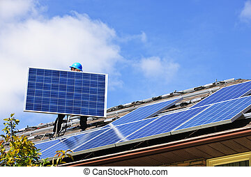 Solar panel installation - Worker installing alternative...