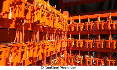 Small Torii gates with written wishes and offerings made of...