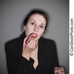 Woman put on lipstick