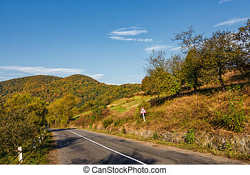 asphalt road in mountainous countryside. beautiful early...