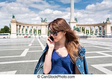 speaking on phone. Stylish city portrait of fashionable...