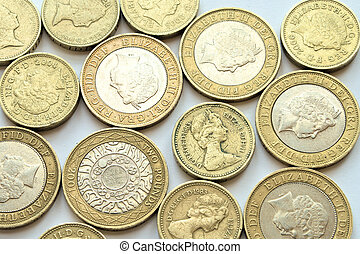 Coins spread out - Pound and two pound coins spread evenly