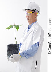 Asian scientist holding plant