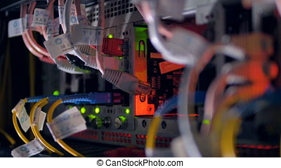 Cables and lights at data Center Servers. Backview. 4K. -...
