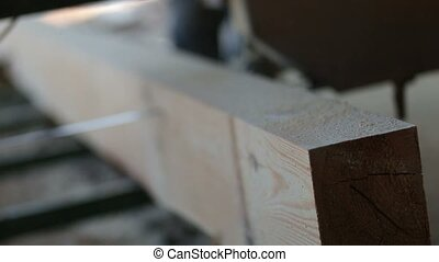Industrial band-saw cutting timber into planks - Close-up of...