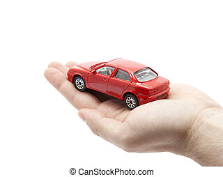 Hand holding a small red car. Clipping path included