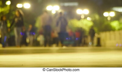 Crowd of People is Walking Along the Night Street....