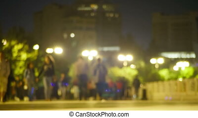 Crowd of People is Walking Along the Night Street. Time...