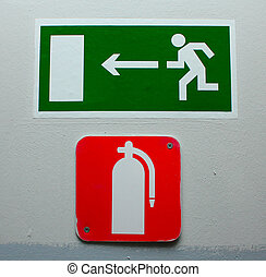 Fire exit - Red Fire Extinguisher Sign on the office wall