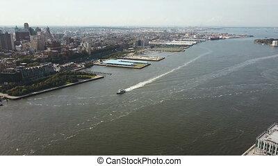 Aerial view of the East river, boat riding through the water...