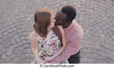 happy interracial couple is kissing - cute interracial...