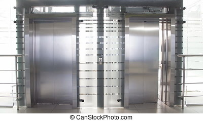 Businessman coming out of the elevator in office