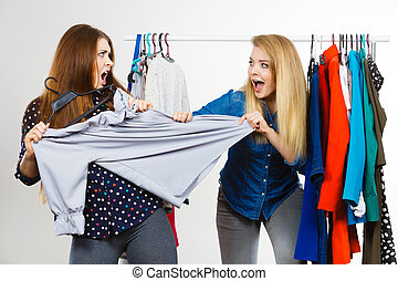 Women arguing during clothes shopping - Two funny women