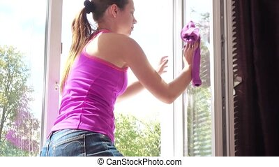 Washing of house windows - The girl washes the window at...