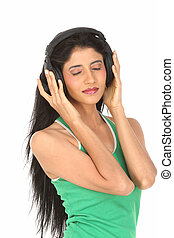 teenage girl with head phones - teenage girl enjoying music...