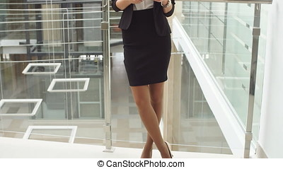 Businesswoman Using Tablet in Office Building.
